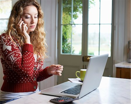 person on phone with credit card - Woman shopping on telephone Stock Photo - Premium Royalty-Free, Code: 6113-06754194