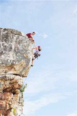 Climbers scaling steep rock face Stock Photo - Premium Royalty-Free, Code: 6113-06754103