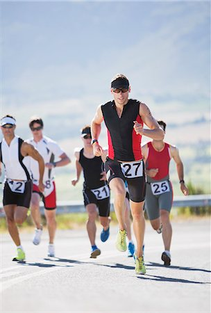 five people - Runners in race on rural road Stock Photo - Premium Royalty-Free, Code: 6113-06754100