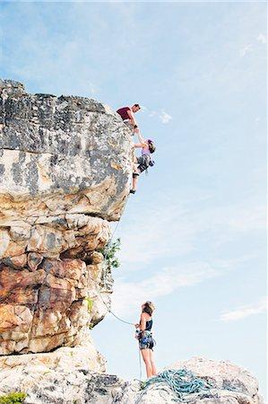 rock climber - Climbers scaling steep rock face Stock Photo - Premium Royalty-Free, Code: 6113-06754105