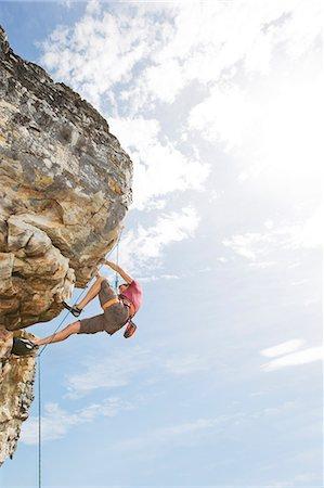 rock climber - Climber scaling steep rock face Stock Photo - Premium Royalty-Free, Code: 6113-06754110