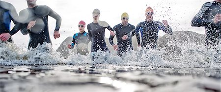 Triathletes emerging from water Stock Photo - Premium Royalty-Free, Code: 6113-06754120