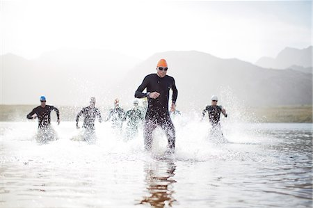 swimming - Triathletes emerging from water Stock Photo - Premium Royalty-Free, Code: 6113-06754122