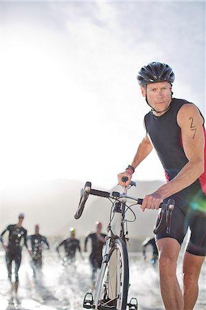 swimming - Man pushing bicycle on beach Stock Photo - Premium Royalty-Free, Code: 6113-06754126