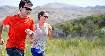 partnership - Couple running in rural landscape Stock Photo - Premium Royalty-Free, Code: 6113-06754136