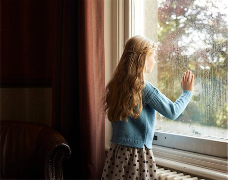 Girl looking out window Stock Photo - Premium Royalty-Free, Code: 6113-06720256