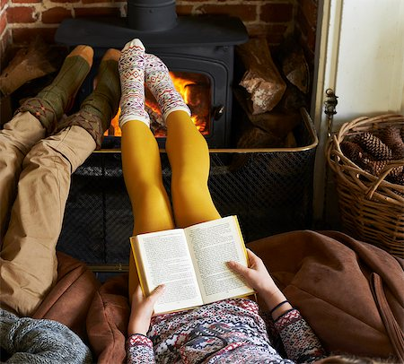 preteen feet - Children relaxing by fire Stock Photo - Premium Royalty-Free, Code: 6113-06720262