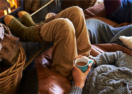 sweater - Boy drinking cup of coffee by fire Stock Photo - Premium Royalty-Free, Code: 6113-06720283