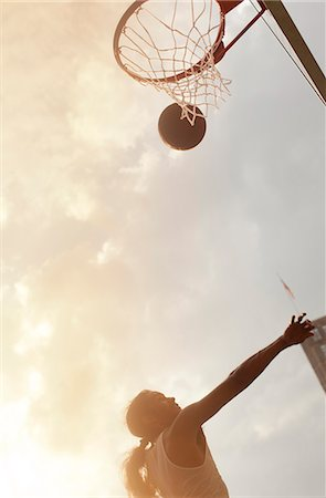 scoring - Man playing basketball on court Stock Photo - Premium Royalty-Free, Code: 6113-06720397