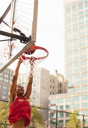 Man dunking basketball on court Stock Photo - Premium Royalty-Free, Code: 6113-06720396