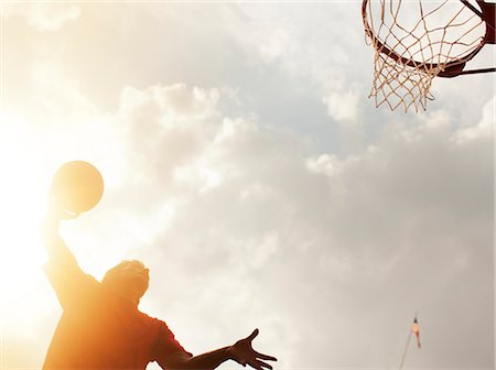 scoring - Man dunking basketball on court Stock Photo - Premium Royalty-Free, Code: 6113-06720400