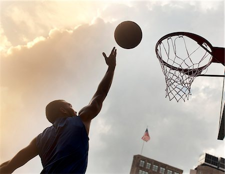 scoring - Man playing basketball on court Stock Photo - Premium Royalty-Free, Code: 6113-06720408