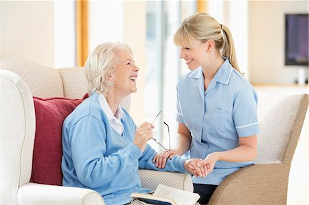 Caregiver talking with older woman Stock Photo - Premium Royalty-Free, Code: 6113-06720570