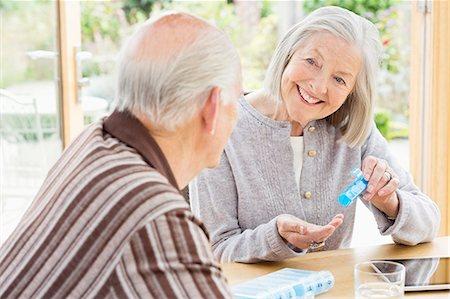 Caucasian couple organizing pills Stock Photo - Premium Royalty-Free, Code: 6113-06720596