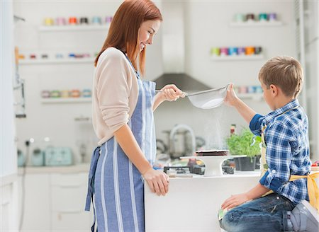 Mother and son baking in kitchen Stock Photo - Premium Royalty-Free, Code: 6113-06720683