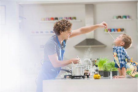Father and son cooking in kitchen Stock Photo - Premium Royalty-Free, Code: 6113-06720680