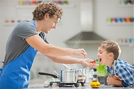 Father and son cooking in kitchen Stock Photo - Premium Royalty-Free, Code: 6113-06720696