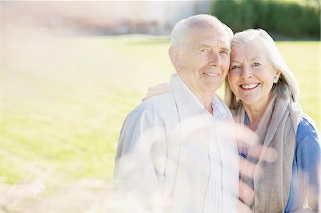 Older couple smiling outdoors Stock Photo - Premium Royalty-Free, Code: 6113-06720612
