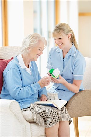 Caregiver talking with older woman Stock Photo - Premium Royalty-Free, Code: 6113-06720632