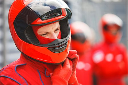 Racer tying on helmet on track Stock Photo - Premium Royalty-Free, Code: 6113-06720741