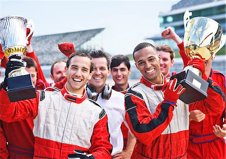 Racers and team cheering on track Stock Photo - Premium Royalty-Free, Code: 6113-06720761