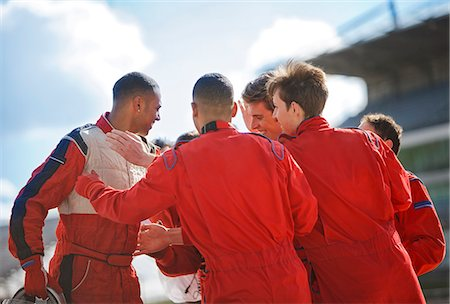race track (people) - Racer and team talking on track Stock Photo - Premium Royalty-Free, Code: 6113-06720765