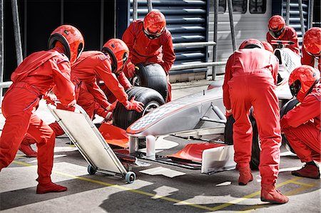 race track (people) - Racing team working at pit stop Stock Photo - Premium Royalty-Free, Code: 6113-06720795