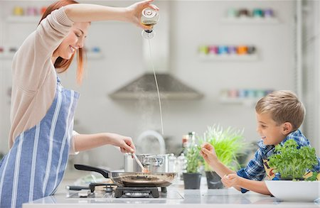 Mother and son cooking in kitchen Stock Photo - Premium Royalty-Free, Code: 6113-06720700