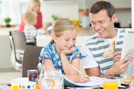 Father and daughter having breakfast Stock Photo - Premium Royalty-Free, Code: 6113-06720704