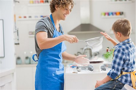 Father and son baking in kitchen Stock Photo - Premium Royalty-Free, Code: 6113-06720706