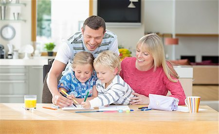 Family coloring together at table Stock Photo - Premium Royalty-Free, Code: 6113-06720715