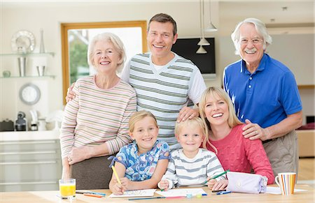 Family smiling together in kitchen Stock Photo - Premium Royalty-Free, Code: 6113-06720718
