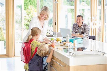 Family talking in kitchen Stock Photo - Premium Royalty-Free, Code: 6113-06720720