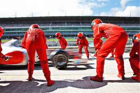 race track (people) - Racing team working at pit stop Stock Photo - Premium Royalty-Free, Code: 6113-06720739