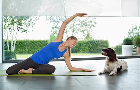 pet - Dog sitting with woman practicing yoga Stock Photo - Premium Royalty-Free, Code: 6113-06720877