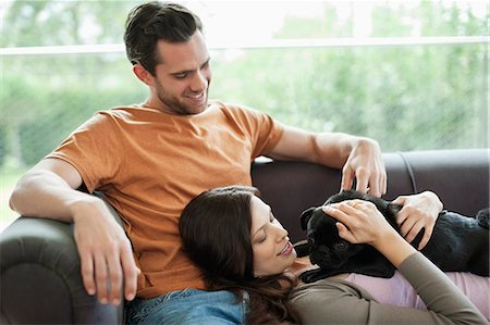 pvg - Couple relaxing with dog on sofa Stock Photo - Premium Royalty-Free, Code: 6113-06720888