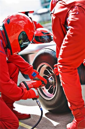 race track (people) - Racing team working at pit stop Stock Photo - Premium Royalty-Free, Code: 6113-06720833