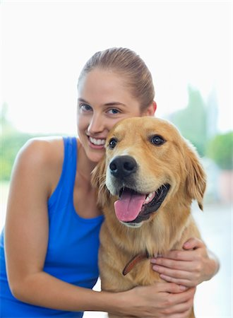 dog and woman and love - Smiling woman hugging dog indoors Stock Photo - Premium Royalty-Free, Code: 6113-06720986