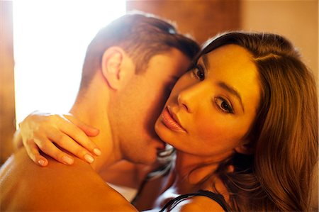 Couple kissing in bedroom Stock Photo - Premium Royalty-Free, Code: 6113-06721054