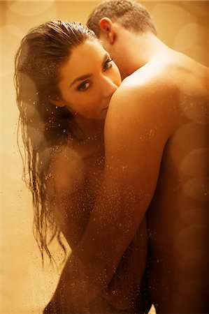 Nude couple kissing in shower Stock Photo - Premium Royalty-Free, Code: 6113-06721058