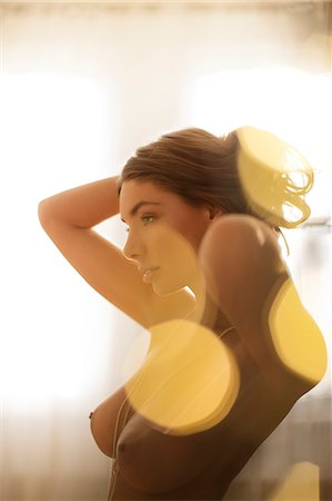 female nude breast sexy - Nude woman playing with her hair Stock Photo - Premium Royalty-Free, Code: 6113-06721076