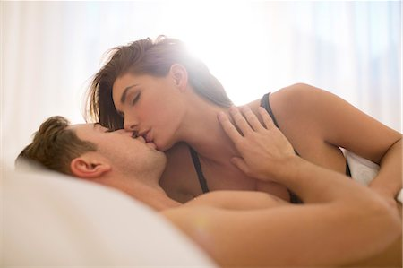romantic couple bed - Couple kissing in bed Stock Photo - Premium Royalty-Free, Code: 6113-06721095