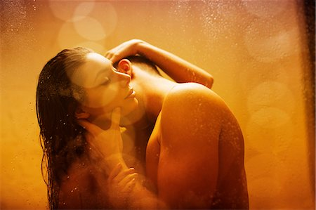 Nude couple kissing in shower Stock Photo - Premium Royalty-Free, Code: 6113-06721098