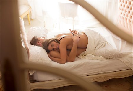 Couple sleeping together in bed Stock Photo - Premium Royalty-Free, Code: 6113-06721022