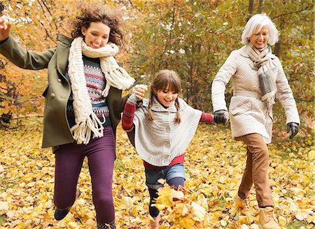 fall - Three generations of women playing in autumn leaves Stock Photo - Premium Royalty-Free, Code: 6113-06721140