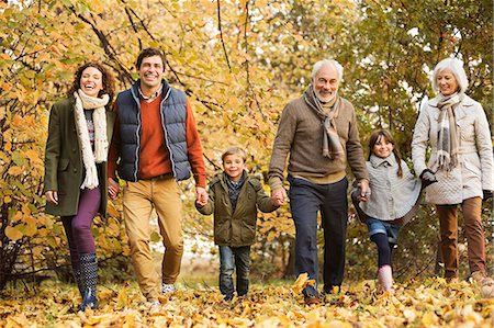 Family walking together in park Stock Photo - Premium Royalty-Free, Code: 6113-06721162