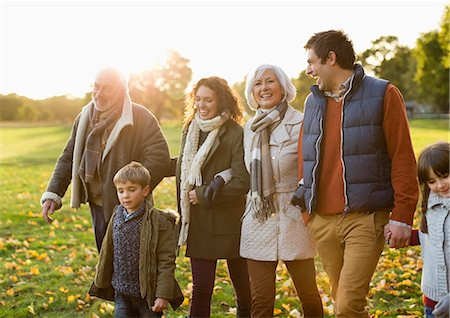 senior lady walking - Family walking together in park Stock Photo - Premium Royalty-Free, Code: 6113-06721172