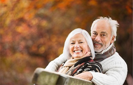 Older couple sitting on park bench Stock Photo - Premium Royalty-Free, Code: 6113-06721189
