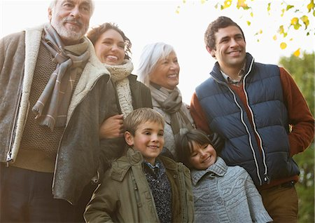 Family smiling together in park Stock Photo - Premium Royalty-Free, Code: 6113-06721195