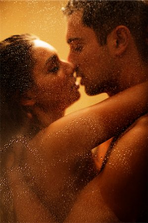 Nude couple kissing in shower Stock Photo - Premium Royalty-Free, Code: 6113-06721103